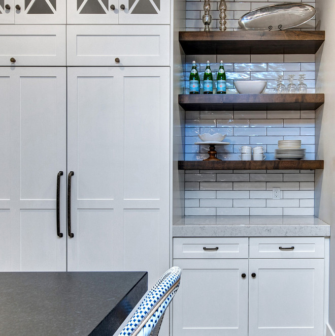 Kitchen combination of cabinets and open wood shelves. The thick wood open shelves feature subway tile backsplash with dark grey grout. #Kitchen #cabinetsandopenshelves #woodshelves #thickwoodshelves #openshelves #subwaytile #backsplash Timberidge Custom Homes