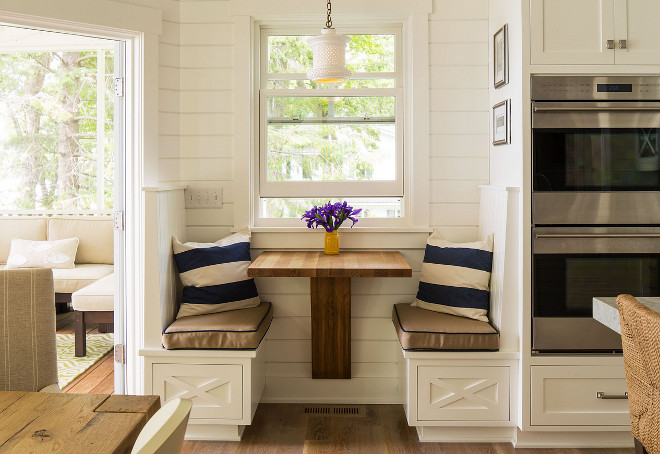 Kitchen nook for two. Cozy nook beside dining area. This cozy kitchen nook is perfect for a quiet coffee time with the paper or tablet. #Cozynook #Kitchennook Sharratt Design & Company