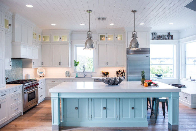 White kitchen with aqua island and tongue and groove ceiling boards. Coastal White kitchen with aqua island and tongue and groove ceiling #Whitekitchen #aquaisland #tongueandgrooveceiling Waterview Kitchens