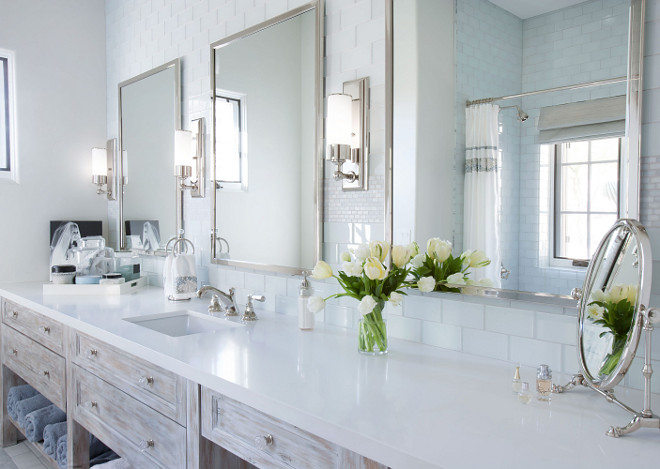 Large bathroom vanity with one sink and plenty of counter space. Cabinet is  rustic whitewashed