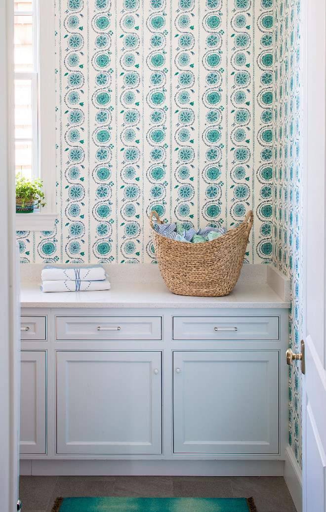 Laundry Room. Laundry room features turquoise and blue wallpaper and soft gray cabinets #LaundryRoom #LaundryroomWallpaper #turquoisewallpaper #turquoiseandbluewallpaper #softgraycabinets #softgraycabinet Andrew Howard Interior Design