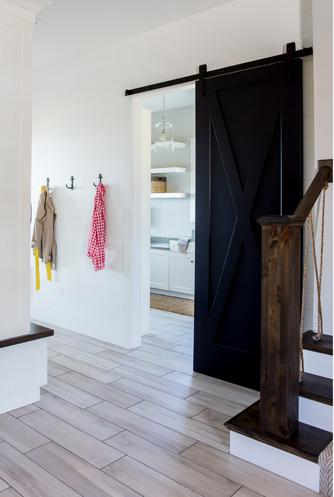 Laundry room Barn Door. Laundry room Barn Door and Staircase with rope railing. Laundry room Barn Door. Laundry room Barn Door #Laundryroom #BarnDoor #Roperailing Timberidge Custom Homes