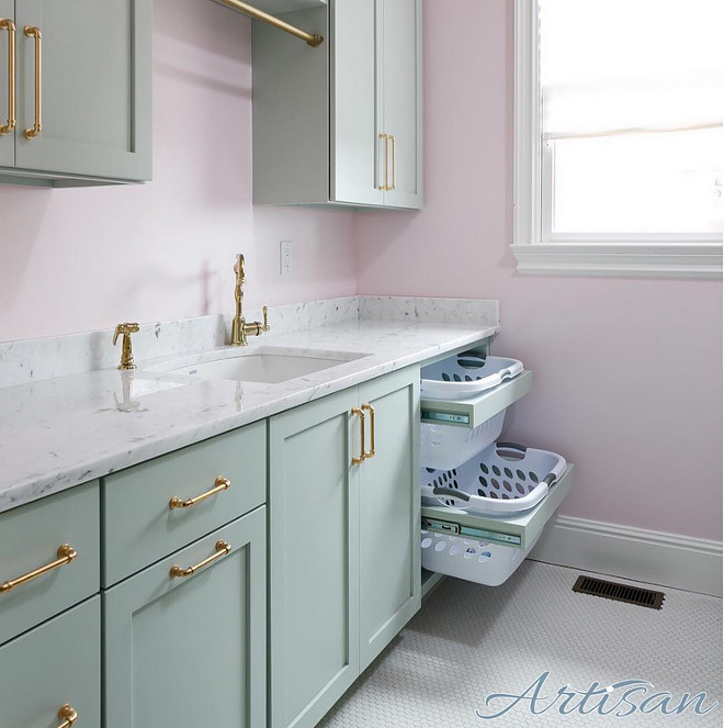 Laundry room. Pale pink walls, turquoise cabinets and brass hardware make for a great laundry room.