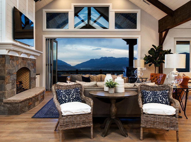 Living room Accordion Door. Living room Accordion Doors. Living room Accordion Doors and Transon Windows. Accordion patio doors allow the indoors to feel completely connected with the outdoors. #Livingroom #AccordionWindows #TransonWindows Timberidge Custom Homes