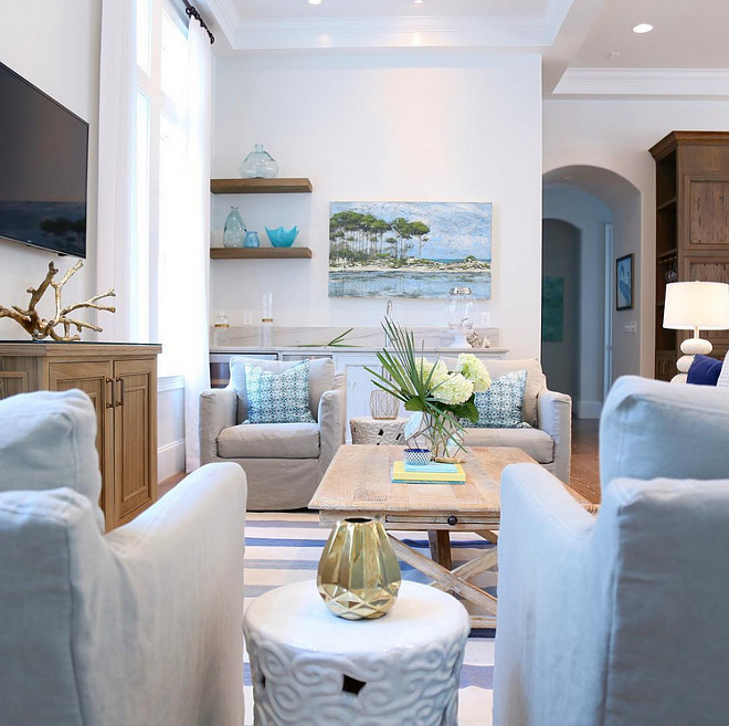 Living room furniture and decor. Perfect harmony of furniture and decor can be found in this coastal inspired living room. #Livingroom #furniture #LivingroomFurniture #Livingroomdecor #decor #coastalinspired #coastallivingroom #coastalinspiredlivingroom