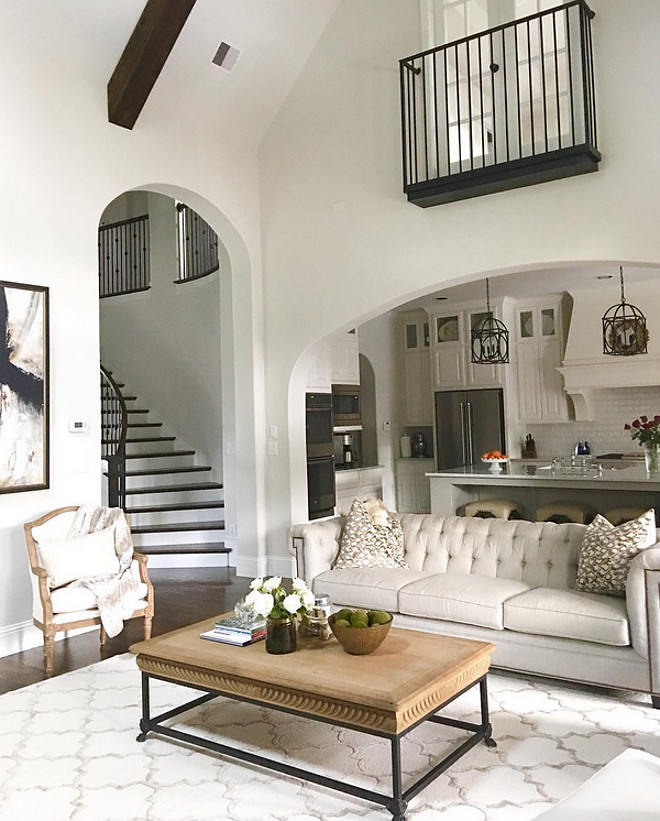 Living room furniture. This grey living room with vaulted ceiling opens to a white kitchen trough an archway. Living room furniture. Living room furniture #Livingroomfurniture #Livingroom #furniture Beautiful Homes of Instagram: classicstylehome