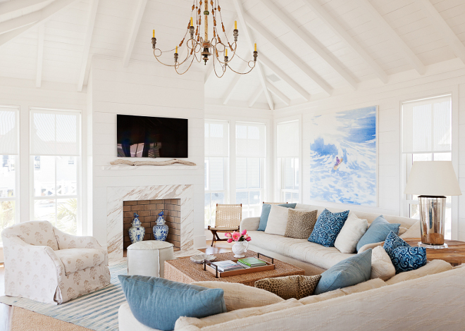 Living room layout. Living room furniture layout. Light and Bright living room with shiplap walls, shiplap vaulted ceiling and with an inspiring furniture layout. #Livingroomlayout #Livingroomfurniturelayout #furniturelayout Beau Clowney Architects. Jenny Keenan Design