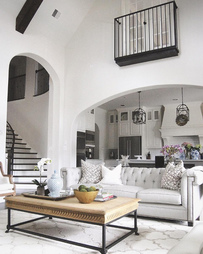 Living room vaulted ceiling opens to kitchen. Grey living room with vaulted ceiling and beams open to white kitchen trough an archway #Livingroom #vaultedceiling #livingroomopenstokitchen #Greylivingroom #ceilingbeams #whitekitchen #livingroomarchway Beautiful Homes of Instagram: classicstylehome