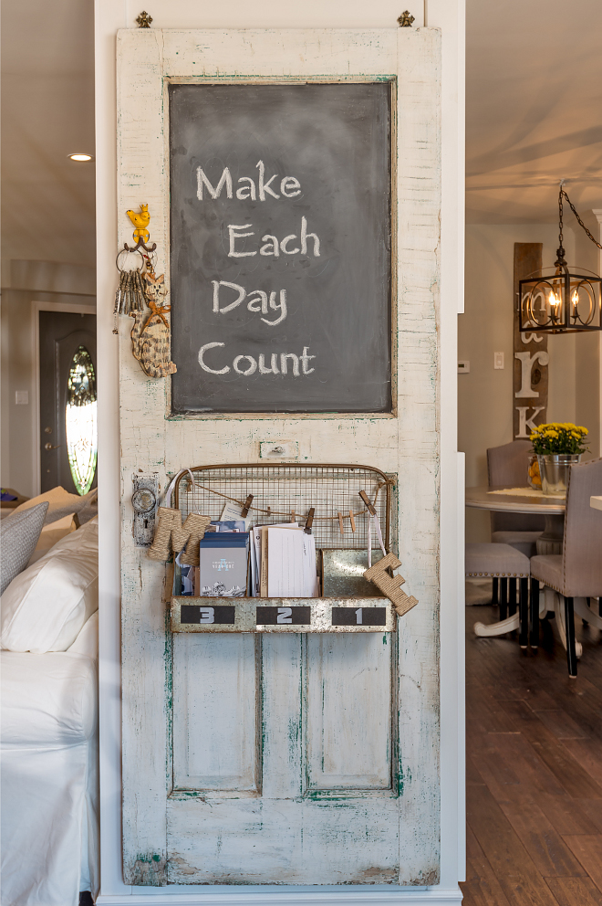 Reclaimed door. Found by the homeowner, this reclaimed door was hung and partly painted with chalk paint to create a message board. How creative is that?! #Reclaimeddoor #chalkpaint #farmhouse Hardcore Renos
