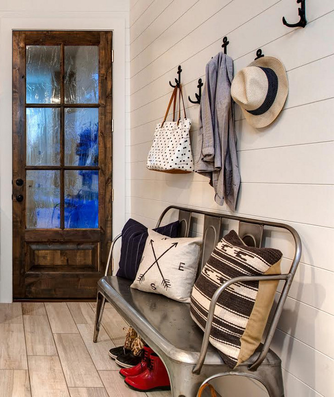 Mudroom Bench. This farmhouse mudroom features shiplap walls, anchor hooks and a metal Tolix bench. #TolixBench #Mudroom #MudroomBench #FarmhouseMudroom #Farmhousebench #Metalbench #shiplapwalls #anchorhooks Timberidge Custom Homes