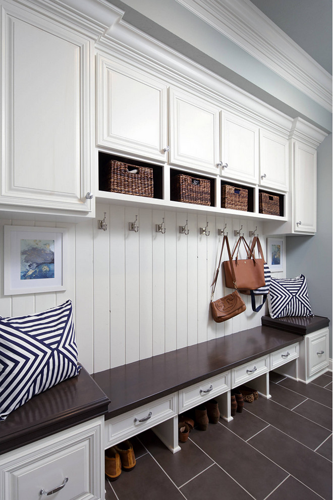 Mudroom Seating and Storage Layout. Floors are 12x24 gray ceramic tile. Mudroom Seating and Storage Layout Ideas. Mudroom Seating and Storage Layout. #Mudroom #MudroomSeating #MudroomStorage #MudroomLayout Barrington Homes Inc.
