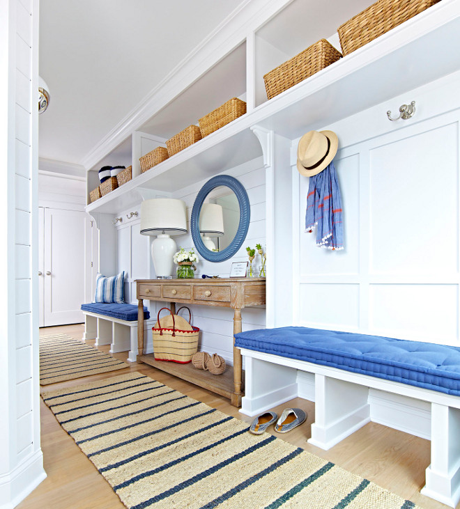 Mudroom. Mudroom Entry. Mudroom Entry with whitre oak flooring, shiplap walls, mundroom benches and open storage with baskets. #Mudroom #Mudroomentry #entry #shiplap #storage #mudroombenches #mundroombaskets #mudroomflooring #whiteoakflooring #openstorage Chango & Co.