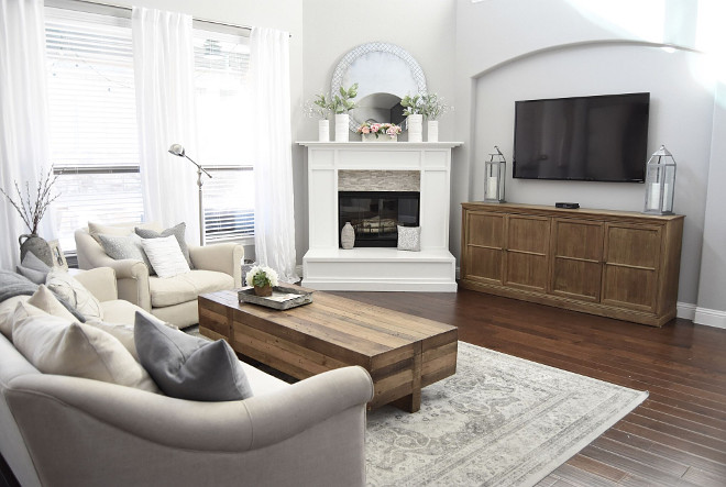 Neutral Family Room. Neutral family room with grey walls, dark hardwood flooring and white fireplace. Neutral Family Room #NeutralFamilyRoom Home Bunch's Beautiful Homes of Instagram Pillow Thought