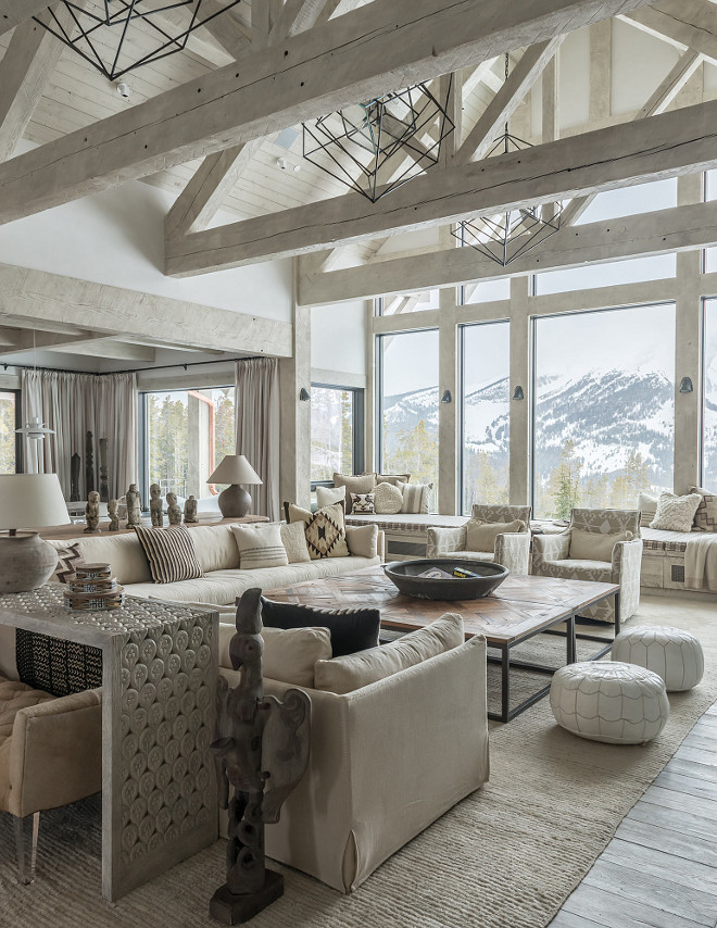 neutral rustic interiors neutral rustic living room with vaulted ceiling and exposed whitewashed beams and