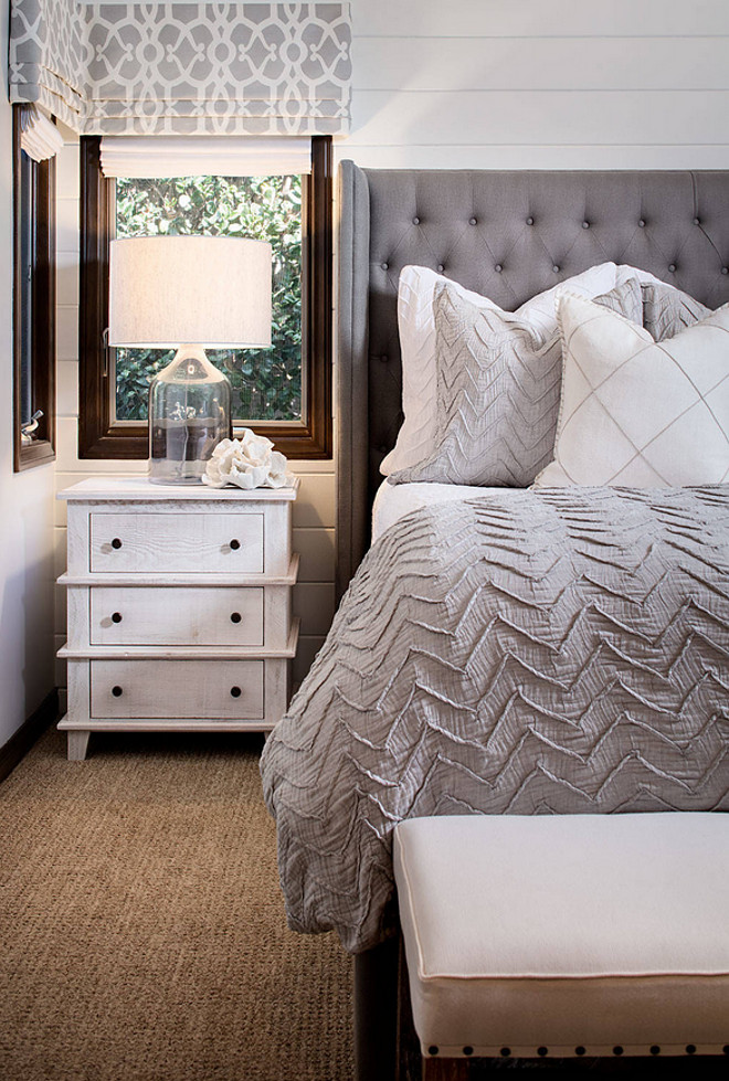 Neutral bedroom with white shiplap walls, grey and white bedding and whitewashed wood nightstand. #Neutralbedroom #Neutralbedroomcolorpalette #colorpalette #whiteshiplapwalls #shiplap #greyandwhitebedding #whitewashedwood #nightstand Tracy Lynn Studio