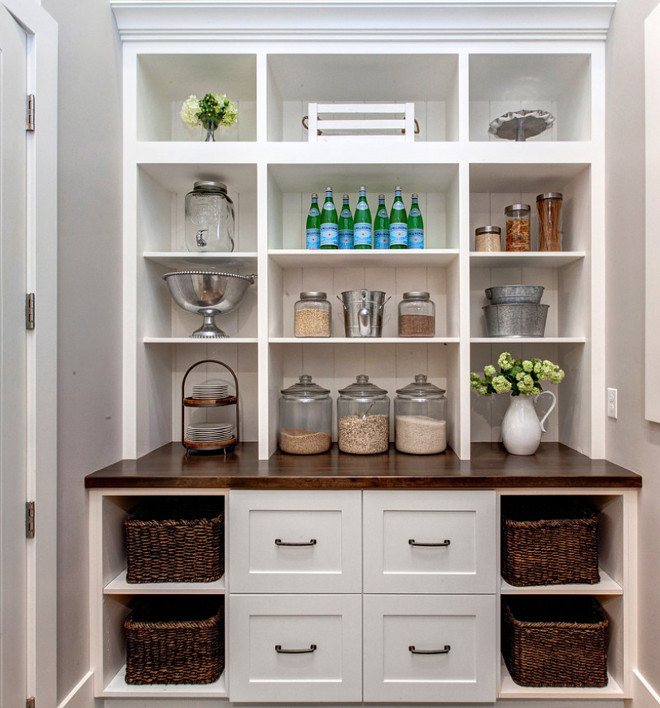 Pantry Built in Cabinet. Kitchen pantry with built in cabinet with open cubbies, butchers block countertop and wicker baskets. #Pantry #PantryBuiltinCabinet #Kitchenpantry #pantrycubbies #butchersblock #butchersblockcountertop #wickerbaskets Timberidge Custom Homes