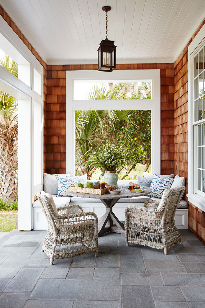 Porch. The porch features a gray stone flooring, a custom banquette and one of my favorites outdoor furniture - Kingsley-Bate. Andrew Howard Interior Design