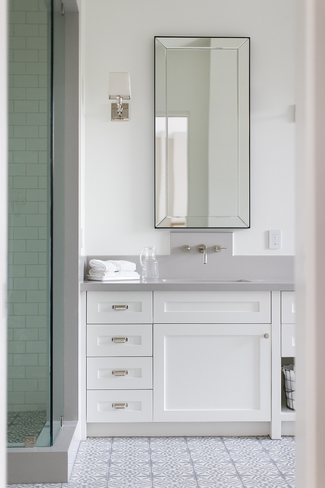 Restoration Hardware Bathroom Mirror. Cabinet paint color is Dunn Edwards Whisper. Countertop is Brushed French Grey Limestone slab. Restoration Hardware Bathroom Mirror Ideas #RestorationHardware #BathroomMirror Patterson Custom Homes