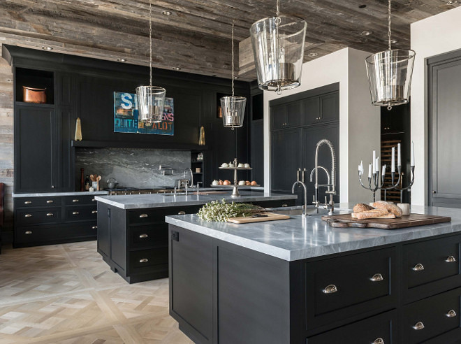 Rustic farmhouse kitchen with black cabinets and reclaimed barnwood shiplap ceiling. Rustic farmhouse kitchen with reclaimed barnwood shiplap ceiling. The kitchen also features custom black matte cabinetry and two islands, which are illuminated with a quartet of Zurich Lanterns by Vaughan Designs. #Rusticfarmhousekitchen #Rustickitchen #farmhousekitchen #blackcabinets #reclaimedshiplap #barnwoodshiplap #shiplapceiling Locati Architects