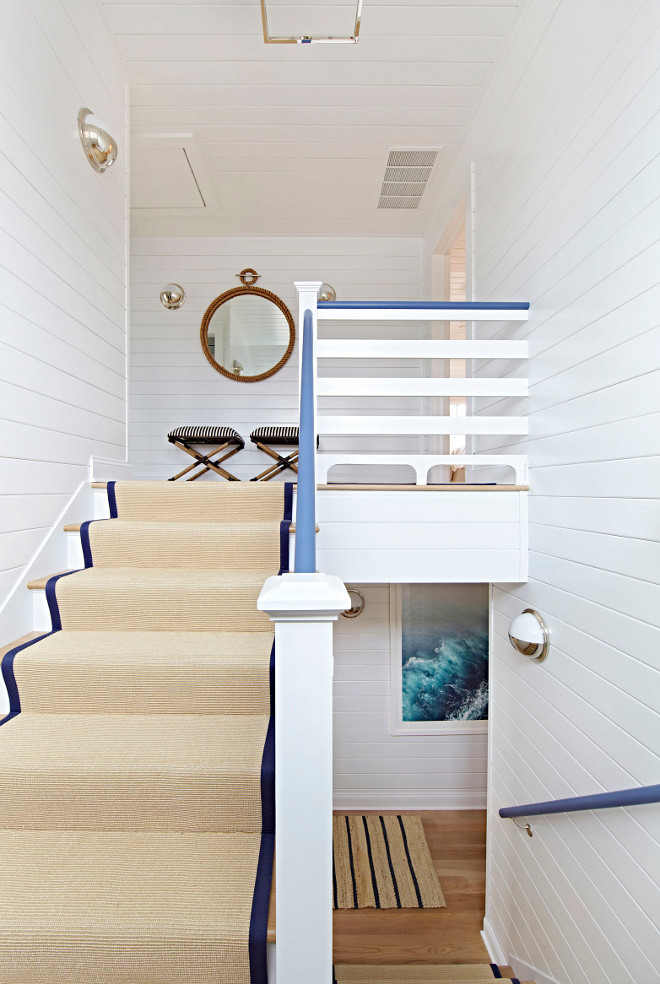 Shiplap Staircase. Shiplap Staircase Ideas. The staircase features shiplap wainscoting and sisal runner. Shiplap Staircase #ShiplapStaircase #Shiplap #Staircase #sisalrunner #staircaserunner Chango & Co.