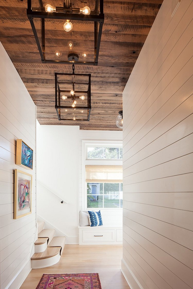 Hall with Shiplap walls and reclaimed shiplap wood ceiling. Hall with Shiplap walls, reclaimed shiplap wood ceiling and industrial lighting #Hall #Shiplapwalls #shiplap #reclaimedshiplapwoodceiling #reclaimedwoodceiling #industriallighting Victoria Balson Interiors