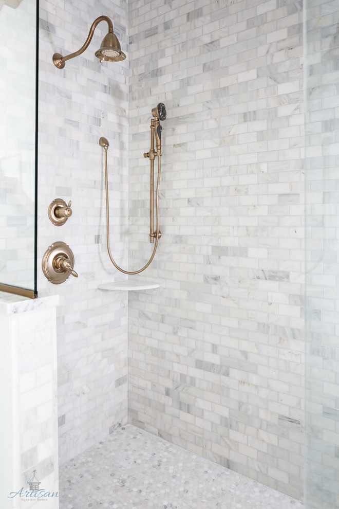 Shower Tile Combination: Marble subway tile on walls and marble penny tile on the floor. #ShowerTileCombination #Marblesubwaytile #walltile #marblepennytile #pennytile Artisan Signature Homes.  Interiors by Gretchen Black