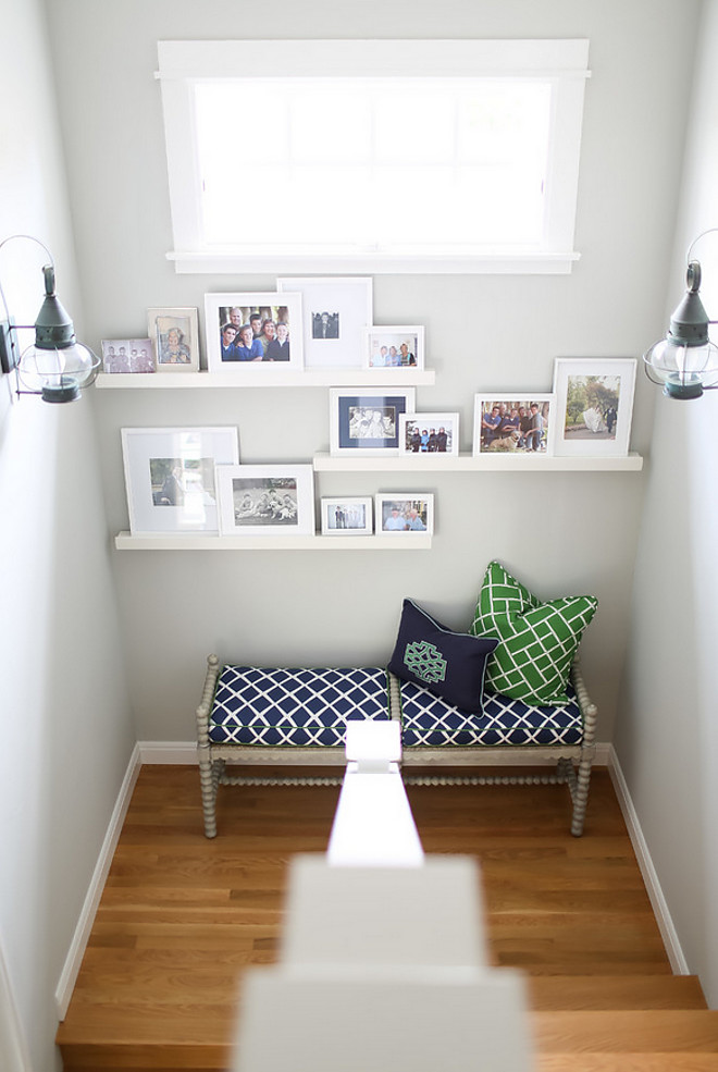 Staircase with bench and photo gallery. Easy and affordable way to decorate that empty space on your stairway. Add a stylish bench and framed photos on Ikea wall shelves. #Staircase #Staircasebench #photogallery #Staircasephotogallery #decorate AGK Design Studio. Ryan Garvin Photography.