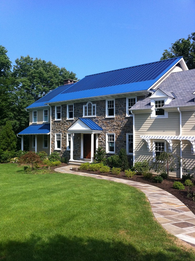 This ocean blue metal roof features a 5 kw solar thin film system that laminates directly to the standing seam panels. By Global Home Improvement.