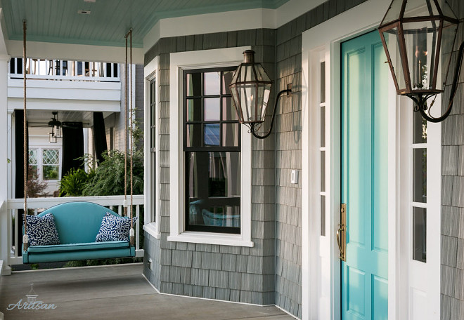 Turquoise and Gray Home Exterior. Home with grey shingles and turquoise teal front door and ceiling paint color. #Turquoisefrontdoor #Turquoiseporch #Grayexterior #HomeExterior Artisan Signature Homes. Interiors by Gretchen Black.