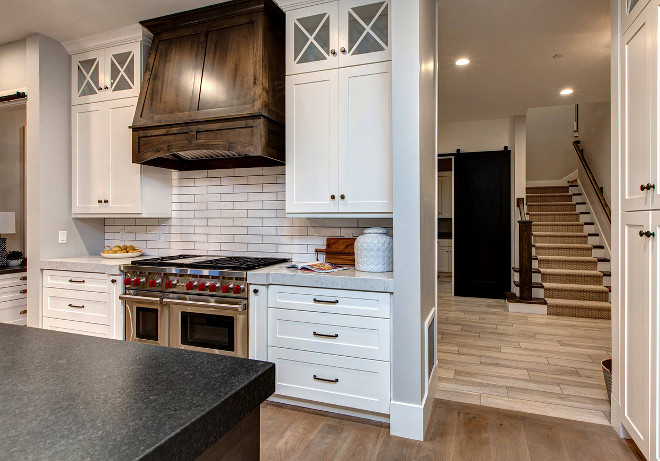 Two toned kitchen. White kitchen dark wood hood and island. #Twotonedkitchen #Whitekitchen #darkwood #hood #island