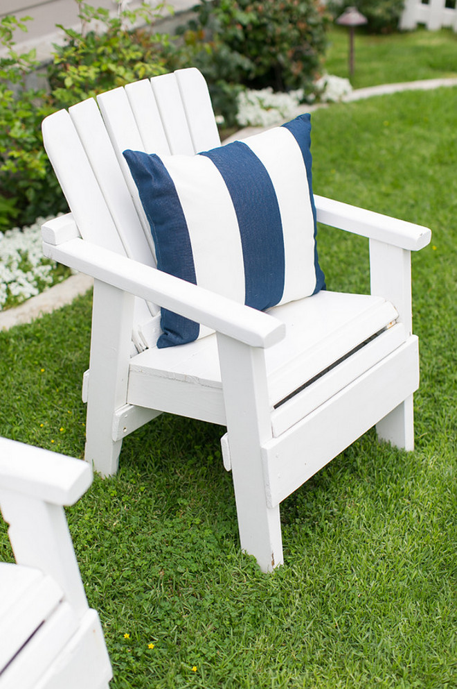 White Adirondack Chair. White Adirondack Chair with Blue and White Striped Pillow. White Adirondack Chair #WhiteAdirondackChair #WhiteAdirondackChairs AGK Design Studio. Ryan Garvin Photography.