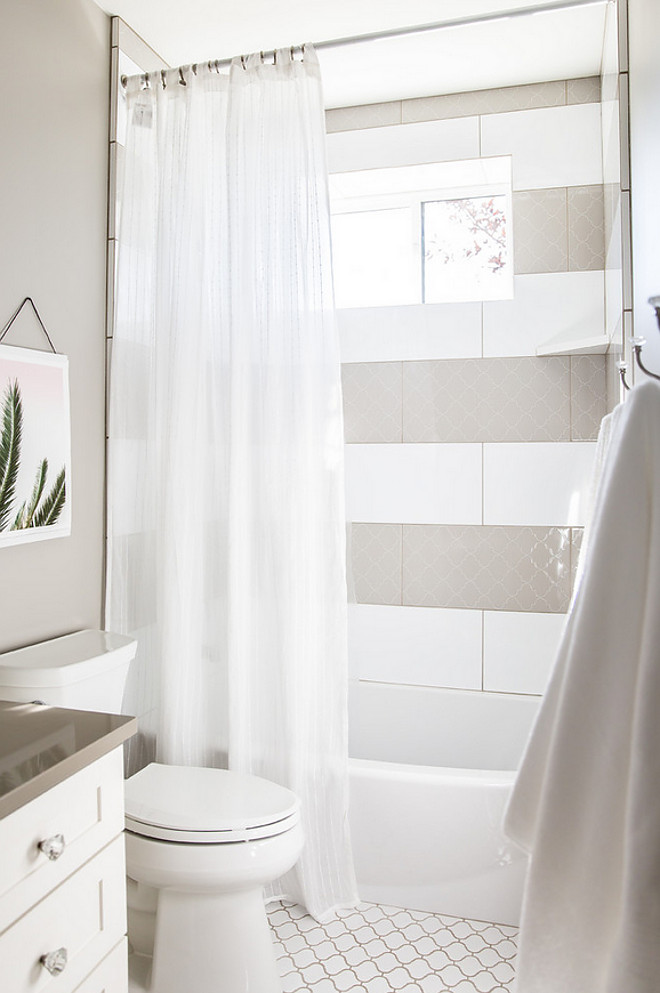 White and grey shower tile. White tile and grey Arabesque tiles are lined in stripes in this shower. #Arabesquetile #showertile #whiteandgreytile Timberidge Custom Homes