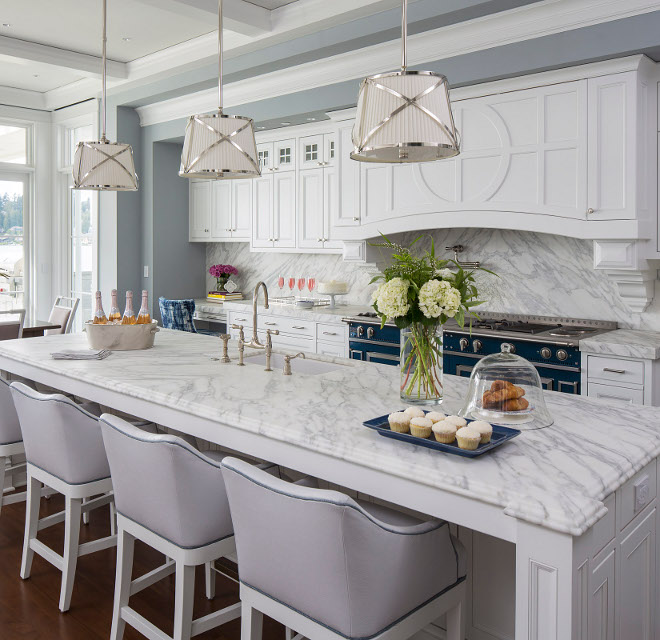 White Clic Kitchen With Marble Countertop And Slab Backsplash The Island