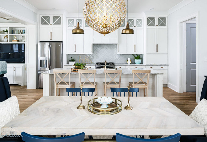 White kitchen with brass lighting and navy accessories. Beautiful White kitchen with brass lighting and navy accessories #Whitekitchen #brasslighting #navyaccessories