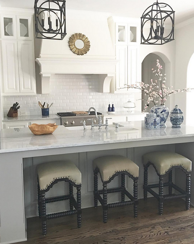 White kitchen with grey island and marble countertop. The grey island ties perfectly with the white cabinets. White kitchen with grey island and marble countertop ideas #Whitekitchen #greyisland #marblecountertop Beautiful Homes of Instagram: classicstylehome