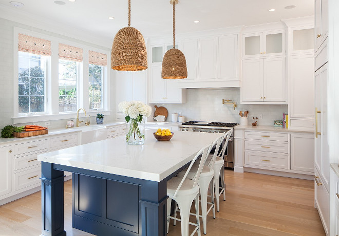 White and navy kitchen. White kitchen with navy island and wicker pendants. #Whitekitchenwithnavyisland #whiteandnavykitchen #wickerpendants Victoria Balson Interiors