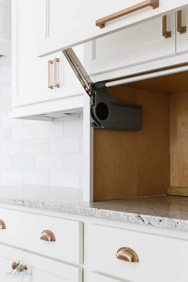 Appliance Garage. We like to hide the coffee maker, toasters and microwave when we can and have utilized these cool countertop cabinets #Appliancegarage