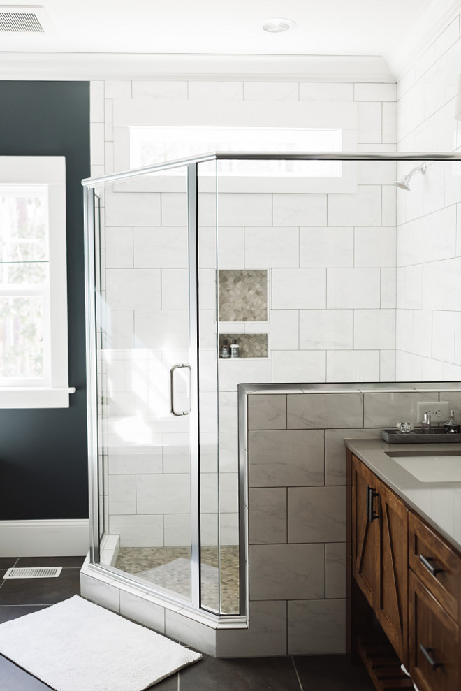 Bathroom shower wall, The semi-frameless glass shower and transom window lets light flood the rest of the bathroom.  Bathroom shower wall ideas. Bathroom shower wall dimensions, Bathroom shower wall #Bathroomshowerwall #Bathroom #showerwall #showerwallideas Beautiful Homes of Instagram @thegraycottage