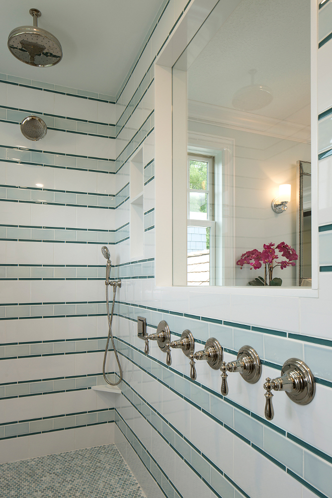 "Bathroom turquoise glass tile, The shower wall pattern is made of 3 different tiles as shown in photo and here's pattern drawing: - 11 rows of 6""h = 66""h (white 6""x12"" subway). ​ ​ - 10 rows of 3""h = 30""h (light green 3""x6"" subway). ​ ​ - 20 rows of 9/16"" = 10""h (darker green glass pencil at 9/16""x6""). White Subway Tile:= Royal Mosa - 15 Thirty; extra white gloss #61213710; 6x12 as the white. Light Green Subway = Pratt & Larson Ceramics PF-36XX/3x6 Field; Glaze Color: R148. Pencil - AEC Hamptons Glass; Wave #GLSHAMWAVSLG; 9/16"" x 6"". The Master Bath shower floor is Lunada Bay Tile; Series: Marbleized; Size: Pennyround; Color: Ice; Finish: Silk​ ​ from RBC Tile​ in Plymouth, MN​ Striped tile pattern ideas, Striped turquoise glass tile, Shower Striped turquoise glass tile #Stripedglasstile #turquoiseglasstile #turquoisetile Grace Hill Design"