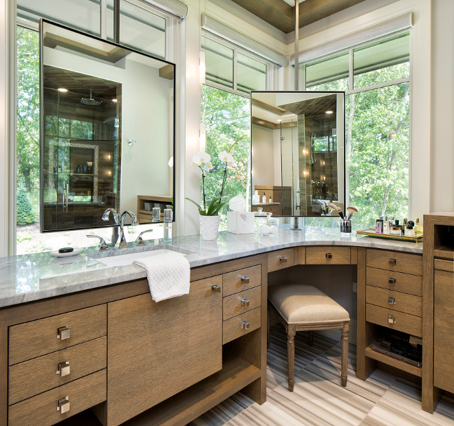Corner Vanity Cabinet, Bathroom with corner vanity and mirror in front of window, These are all custom mirrors and mounting brackets #bathroom #cornervanity #cornercabinet #mirror #mirrorbracket Hendel Homes