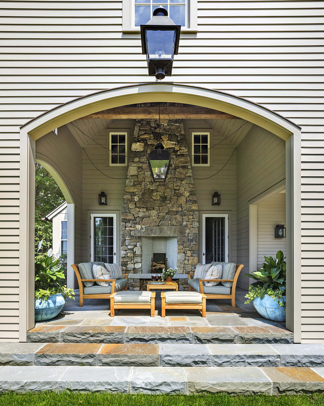 7 decorating tips for backyard patios or outdoor terraces for Covered porch with fireplace