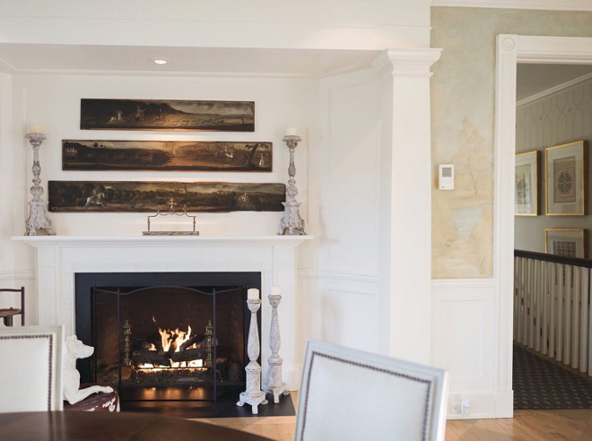Dining room fireplace. Dining room fireplace. Oil on wood panels are from Sotheby's. Candlesticks from Aidan Gray and trim paint is Benjamin Moore OC-85 Mayonnaise. Traditional Dining room fireplace #Diningroomfireplace #diningroom #fireplace Home Bunch's Beautiful Homes of Instagram @loveyourperch