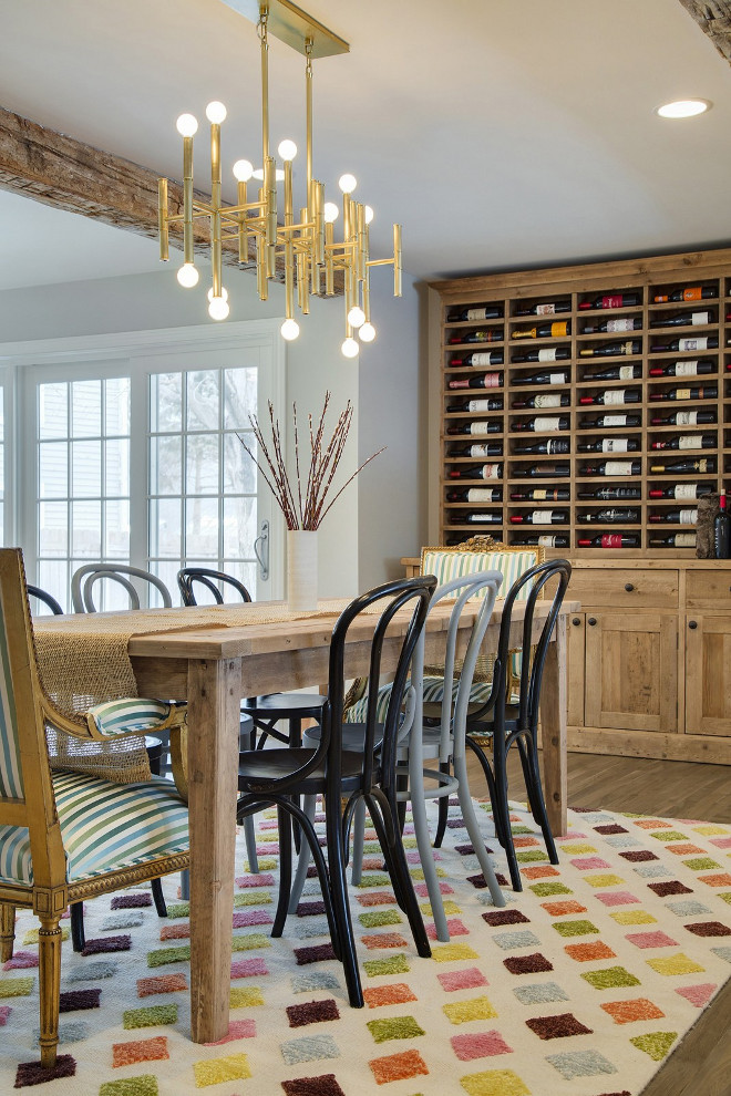 The dining room features a built-in hutch with wine rack. #diningroom #builtinhutch #winerack Revision LLC