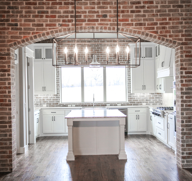Farmhouse Kitchen with Brick arch and brick backsplash. New construction Farmhouse Kitchen with Brick arch and brick backsplash. Brick backsplash is real brick. Farmhouse Kitchen with Brick arch and brick backsplash #FarmhouseKitchen #farmhosue #brick #Brickarch #brickbacksplash #brick #backsplash Crestmont Custom Homes. House Sprucing