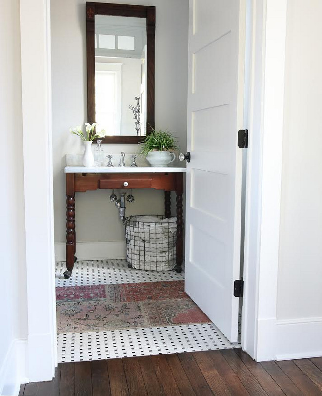 Farmhouse bathroom with repurposed an antique kitchen table and made it into a vanity and vintage runner. #farmhousebathroom #bathroom Beautiful Homes of Instagram @greensprucedesigns