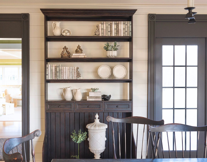 Farmhouse dining room hutch. Farmhouse hutch. Open shelves allow the shiplap wall serve as back to this farmhouse-inspired hutch. Farmhouse dining room with shiplap and farmhouse hutch #Farmhouse #diningroom #hutch #Farmhousehutch #Farmhousediningroom #shiplap #farmhouse #hutch Home Bunch's Beautiful Homes of Instagram @loveyourperch