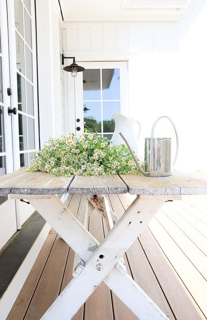 Farmhouse porch with Distressed salvaged trestle table. Farmhouse porch with Distressed salvaged trestle table. Great way to decorate a farmhouse porch #Farmhouseporch #Distressedsalvagedtrestletable Beautiful Homes of Instagram @greensprucedesigns