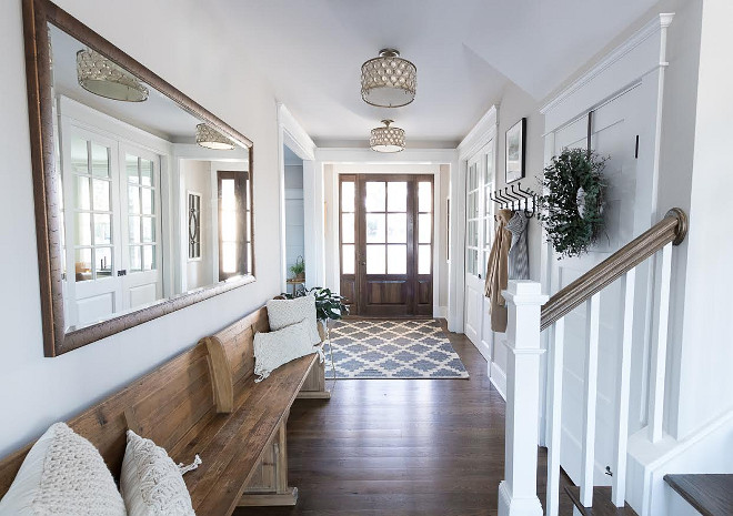Foyer Bench. Light grey foyer with long wood bench, Walnut stained hardwood floors and Walnut front door #Foyer #Bench #Foyerbench #Lightgreyfoyer #longbench #Walnutstainedhardwoodfloors #walnuthardwoodfloors #Walnutfrontdoor Beautiful Homes of Instagram @greensprucedesigns