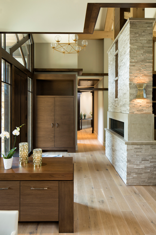 Foyer with fireplace and custom cabinetry for storage, Lighting is Rowan G Chandelier from Worlds Away, Chandelier features gold leaf finish and hand blown glass globes #Foyer #Foyerfireplace #foyercabinetry #foyerstorage Hendel Homes