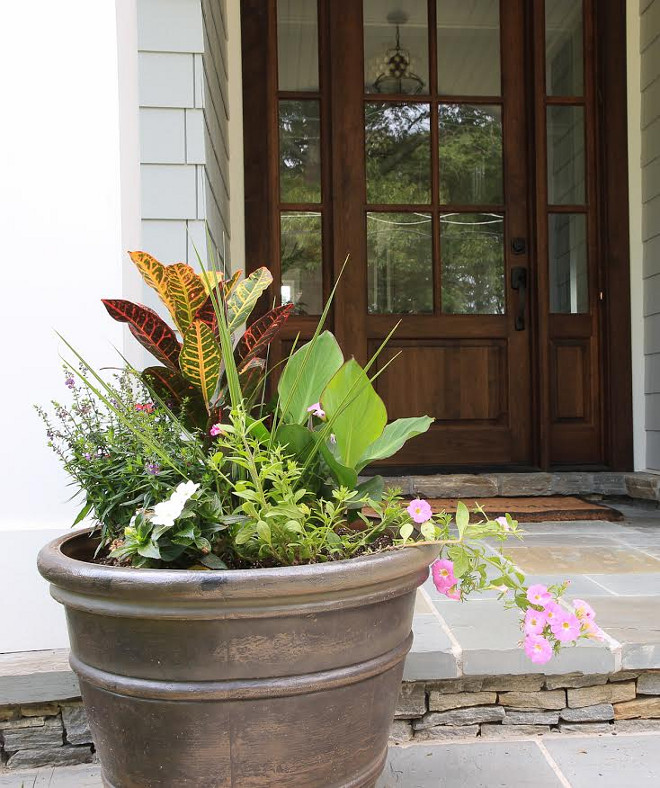 Front entry planter, Walnut front door and Bluestone porch floor tile and Stacked stone porch between steps. Front entry planter, Walnut front door and Bluestone porch floor tile #Frontentry #planter #Walnutfrontdoor #Walnutdoor #Bluestonedfloortile #porch #bluestone #floortile Beautiful Homes of Instagram @greensprucedesigns